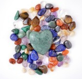 10896710 green quartz heart on pebbles